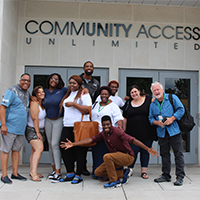 Youth services group outside of CAU building